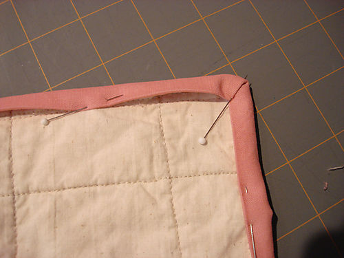 Binding a quilt step 10